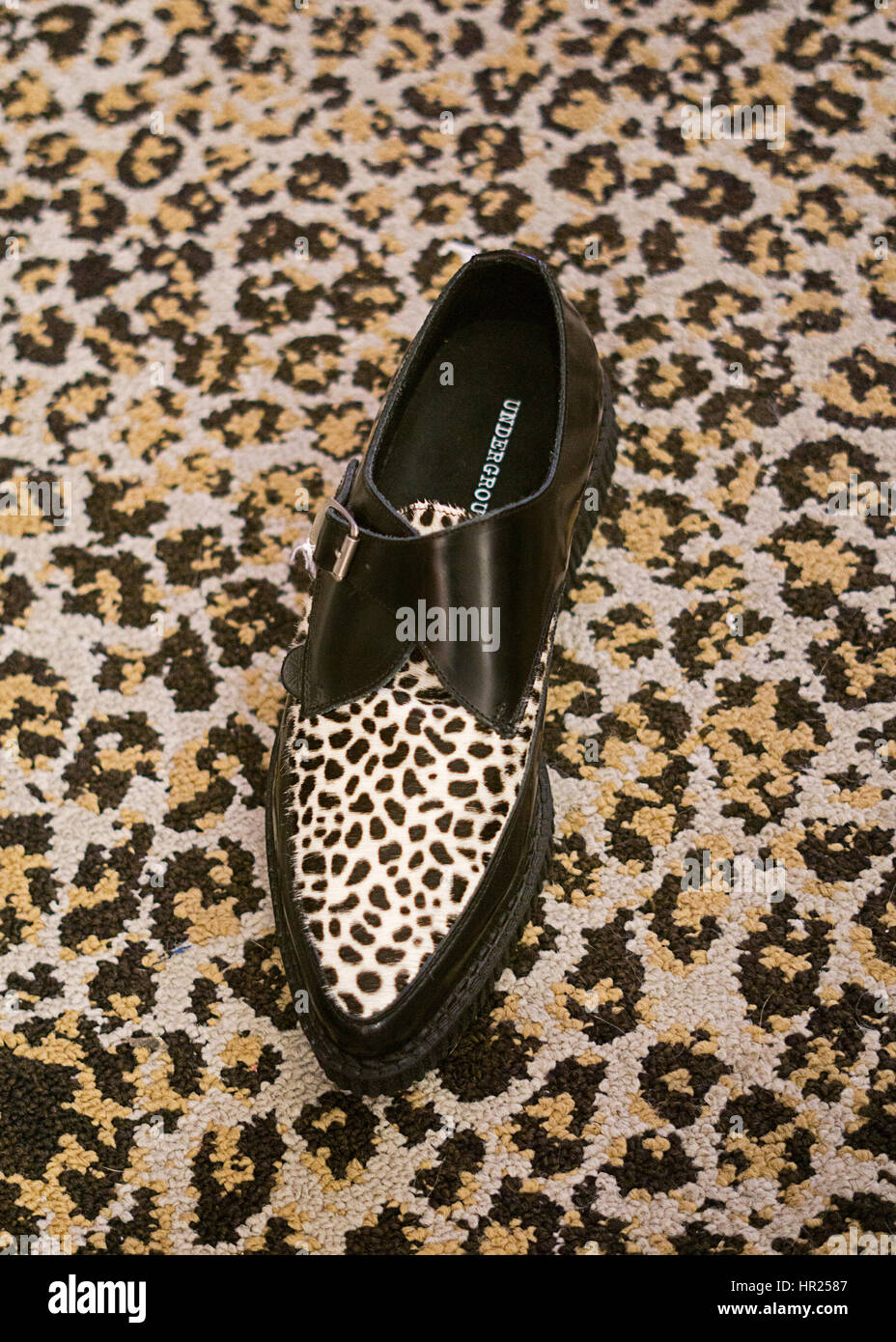 A leopard skin pointy shoe for sale inside the TRASH & VAUDEVILLE alternative fashion shop in the East Village, - Stock Image