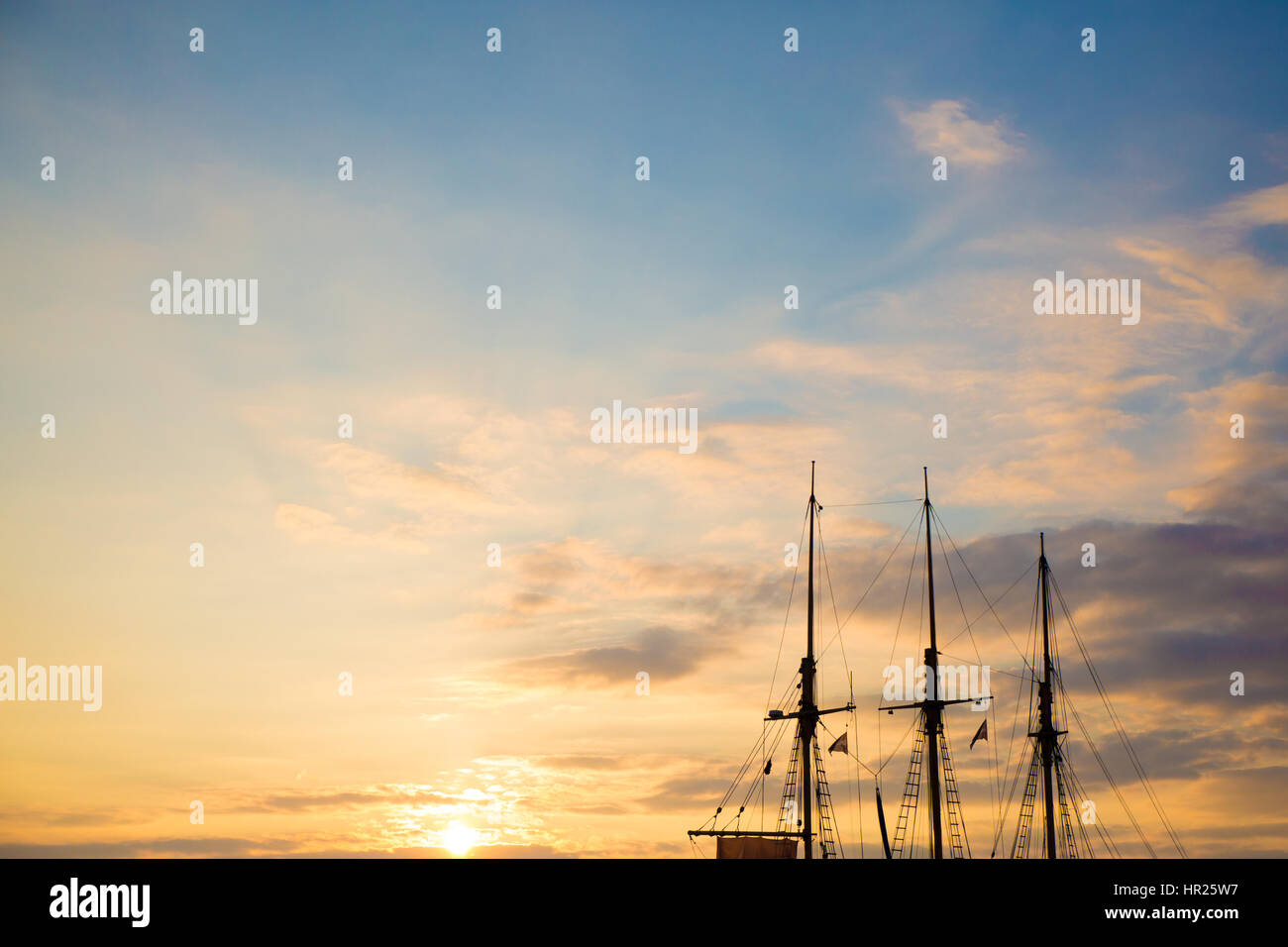 Sunset Over The Ships At Albert Dock, Liverpool, UK - Photo Credit: Michelle Roberts - Stock Image