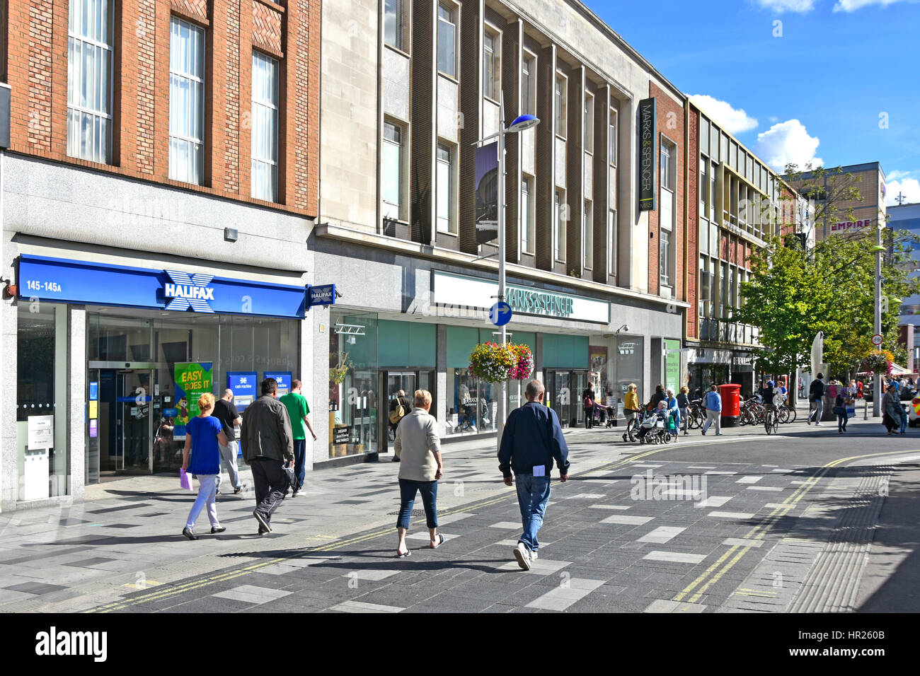 Slough Berkshire UK high street retail shopping centre Halifax Bank Branch & M&S store people walk along - Stock Image