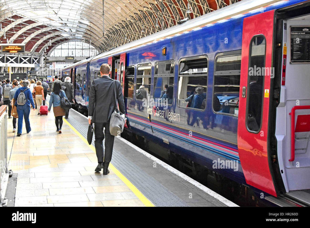 Firstgroup First Great Western train service arrived at Paddington station London UK train platform passengers disembark - Stock Image