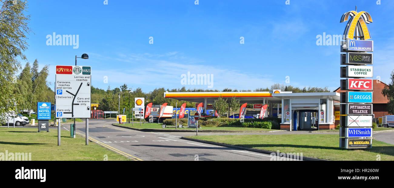 Motorway Service Station Baldock Hertforshire UK Shell petrol filling station site brand logo signs onsite facilities - Stock Image