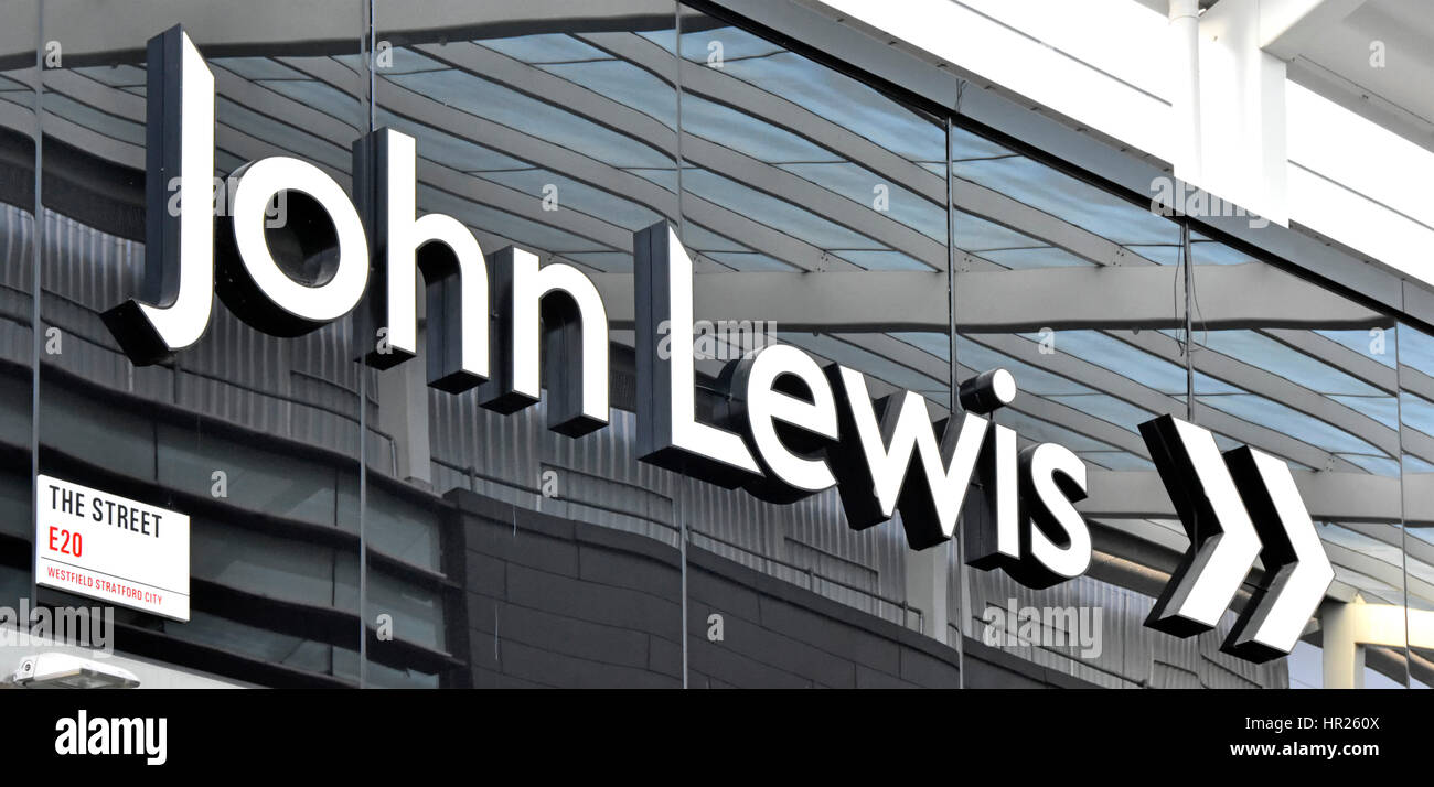 Close up large big John Lewis department store direction sign in shopping mall Westfield Shopping Centre Stratford - Stock Image