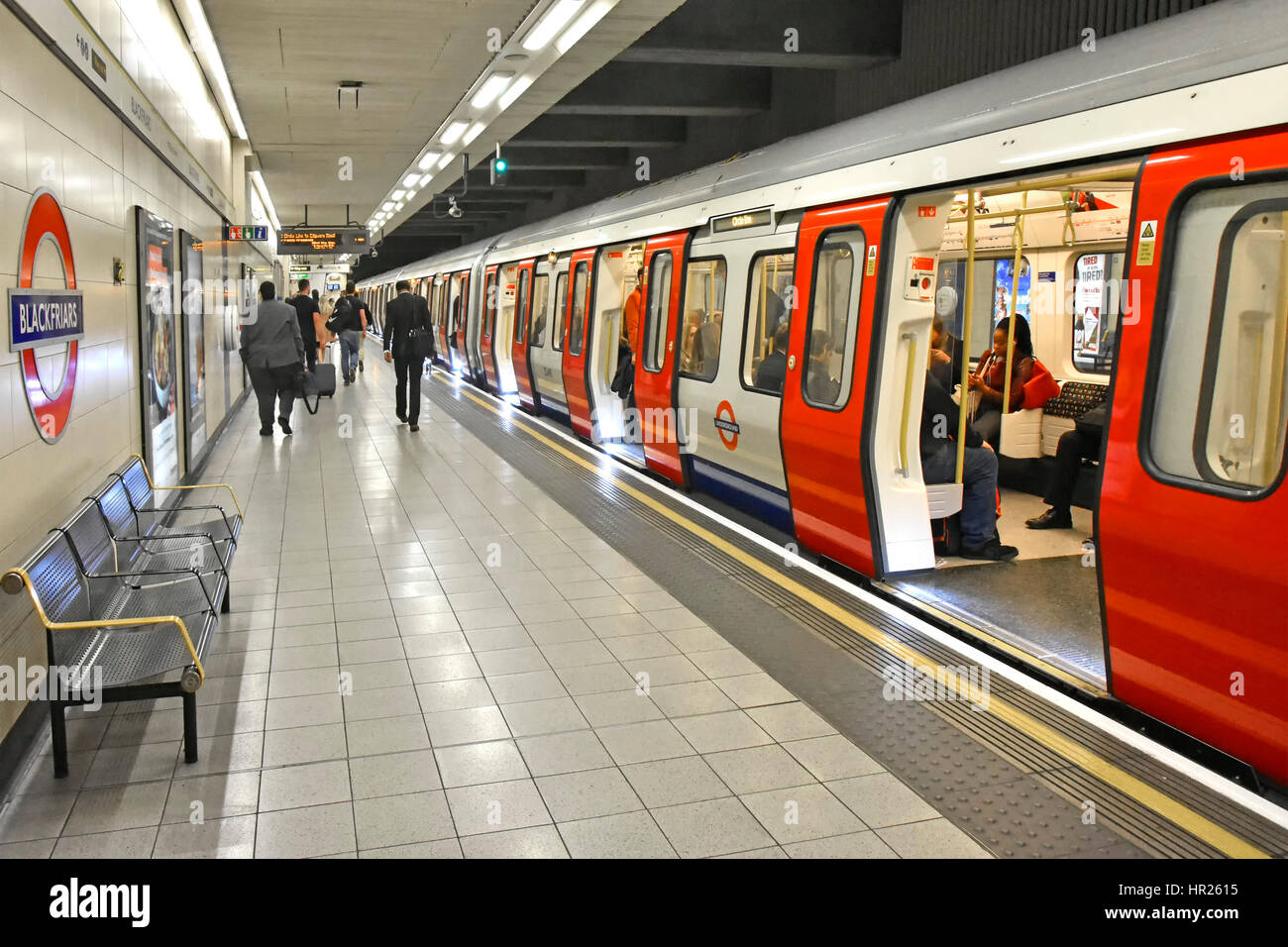 London Underground Blackfriars station platform step free train access for wheelchair disability back view of passengers - Stock Image