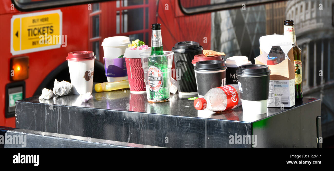 Coffee cup rubbish littering London street together with litter from beer bottle lunch break & paper coffee - Stock Image
