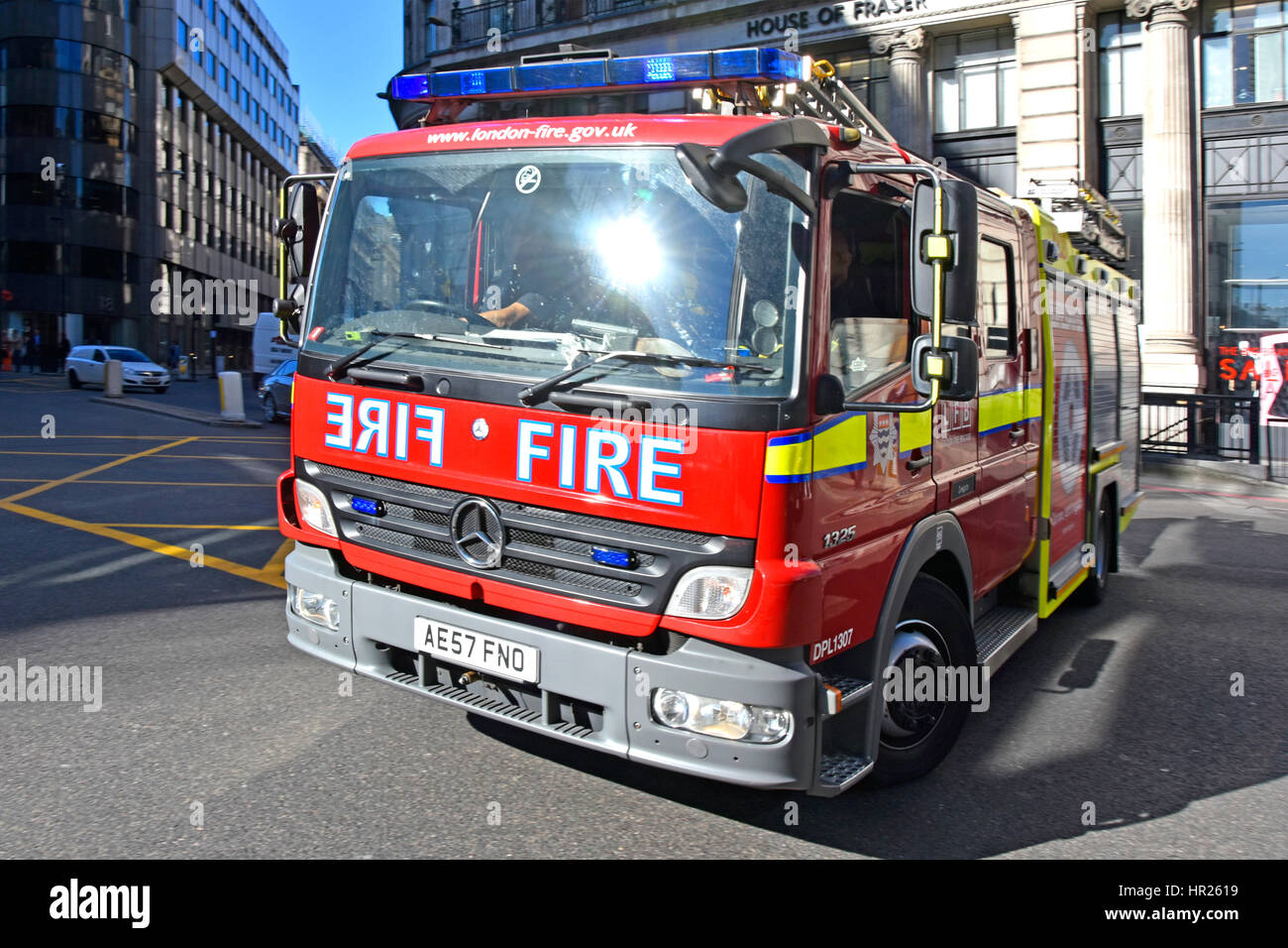 Fire engine emergency services response uk sun flare on windscreen of London Fire brigade Mercedes Benz appliance - Stock Image