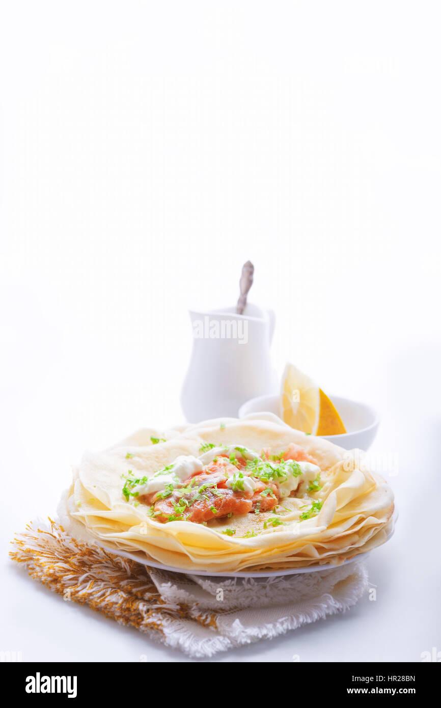 Crepes with smoked salmon. - Stock Image