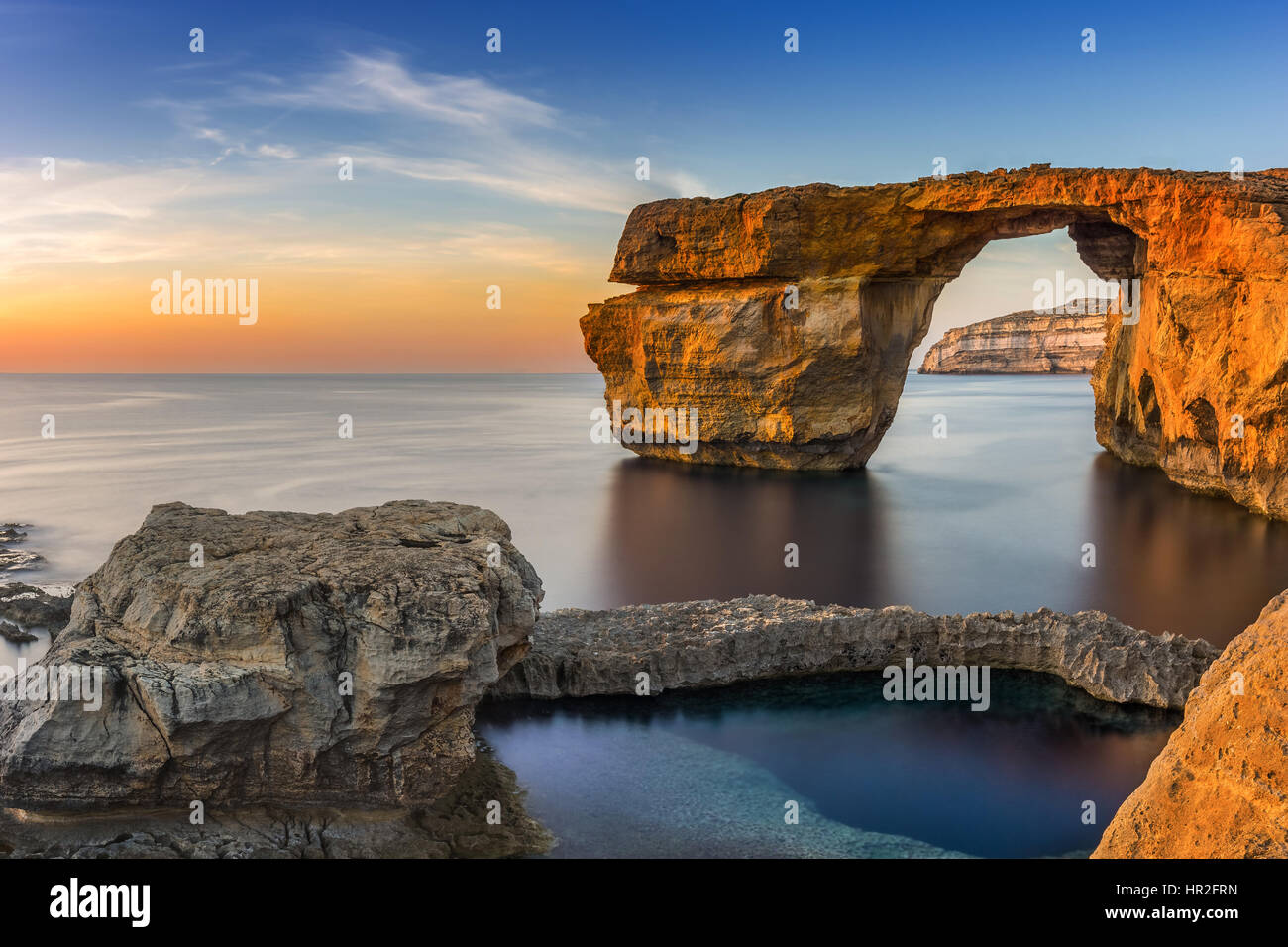 Gozo, Malta - Sunset at the beautiful Azure Window, a natural arch and famous landmark on the island of Gozo - Stock Image