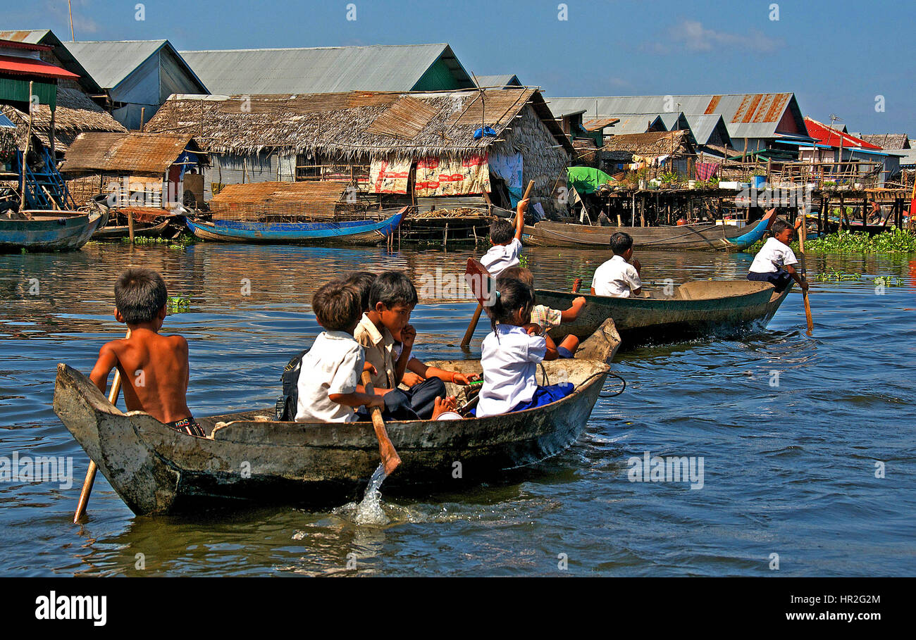 schoolchildren boating onTonle Sap lake, Cambodia - Stock Image