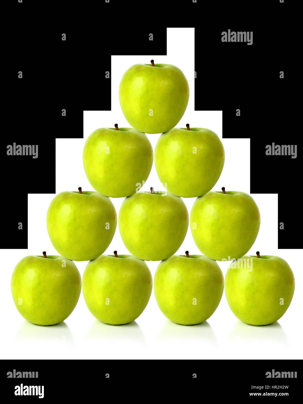 green apples on a pyramid shape over a white background Stock Photo