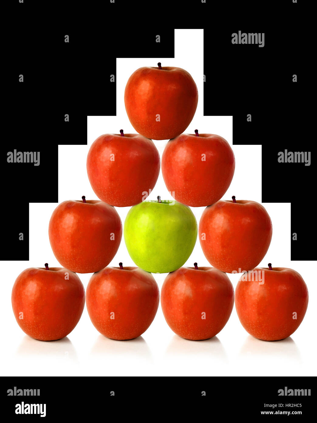 red apples on a pyramid shape over a white background Stock Photo