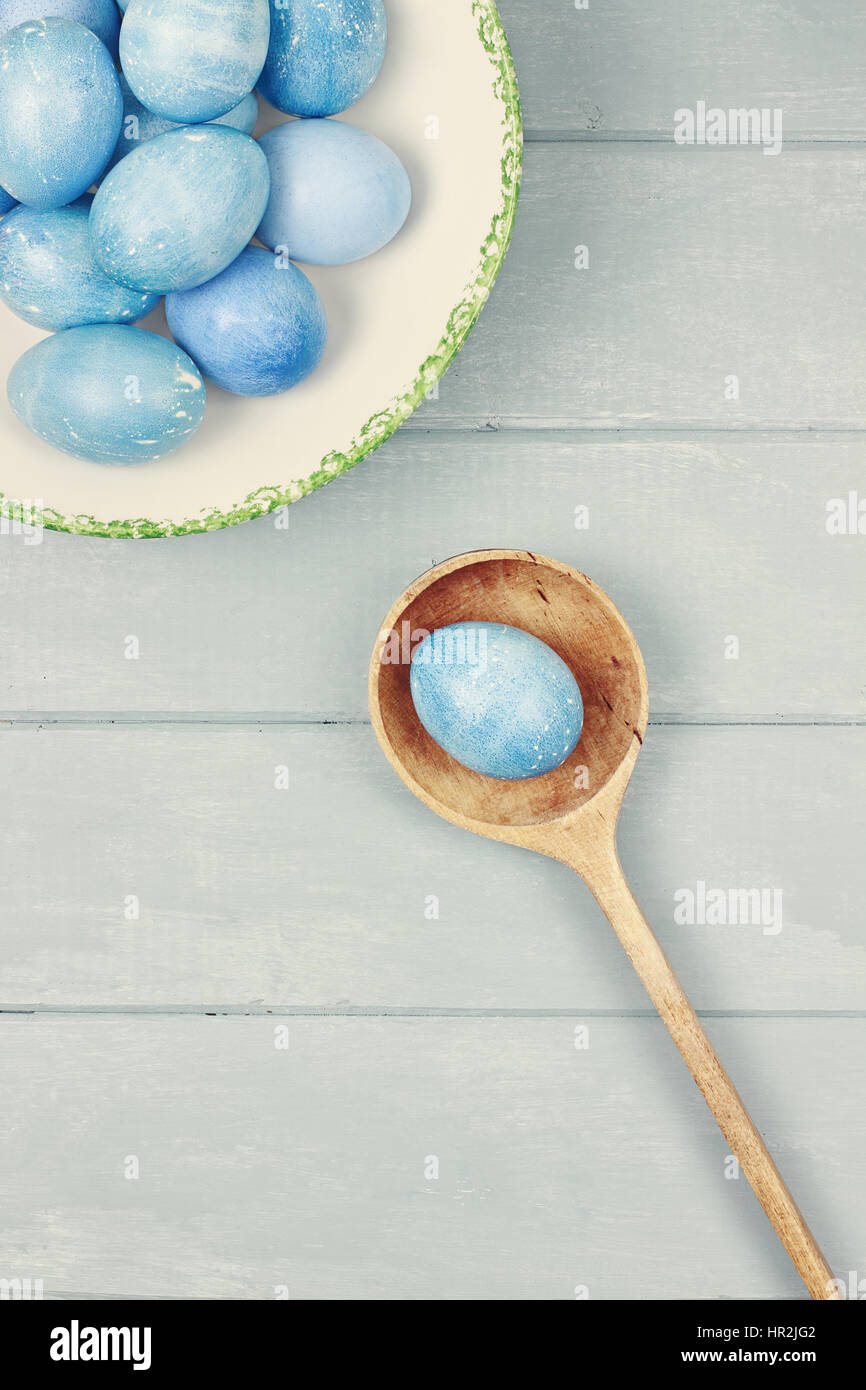 Easter eggs colored a natural blue with room for copy space. - Stock Image