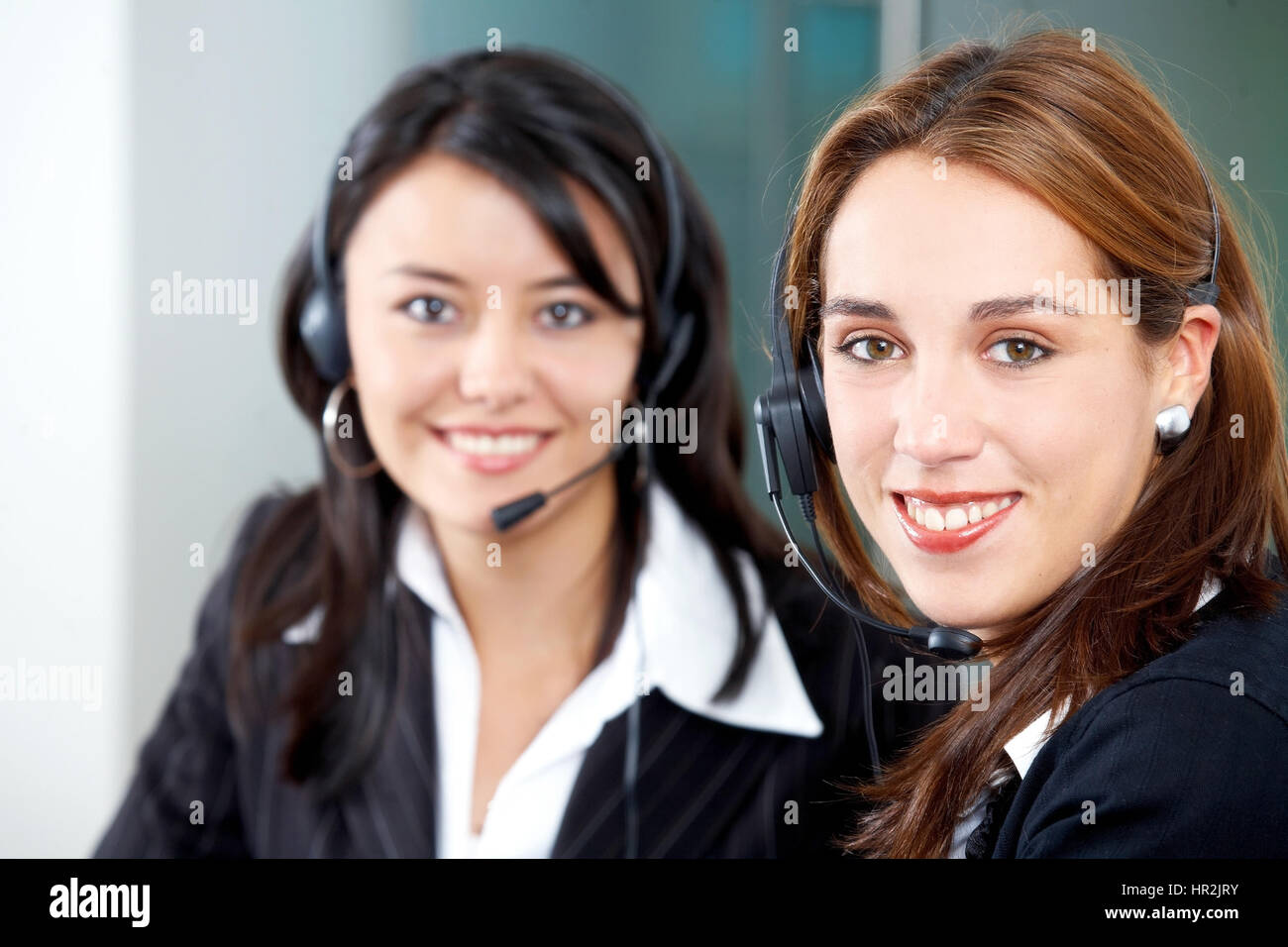 customer service secretaries in an office environment - Stock Image