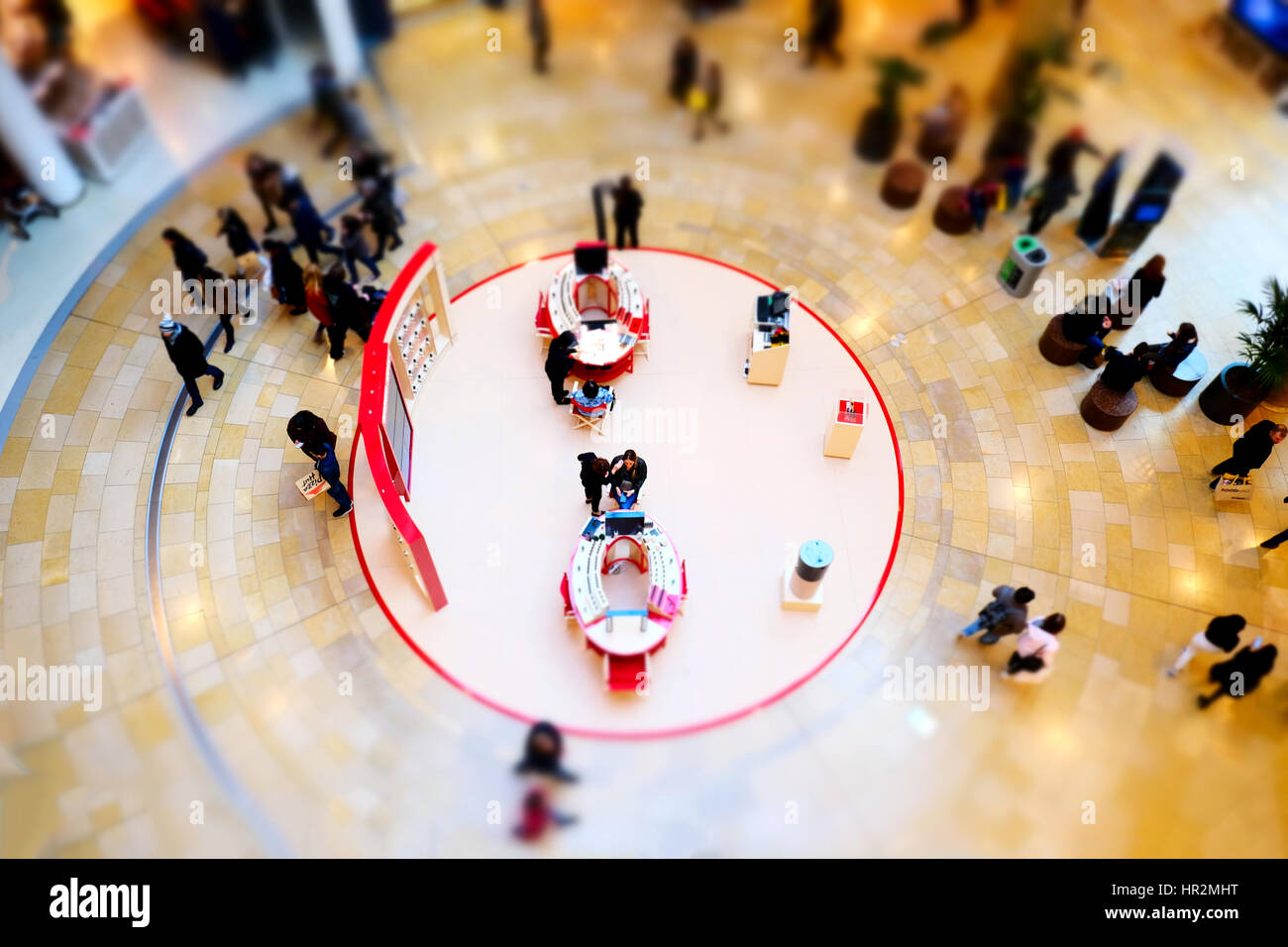 A beauty counter clients made up a busy shopping mall bull ring Birmingham served open area concourse lobby make - Stock Image