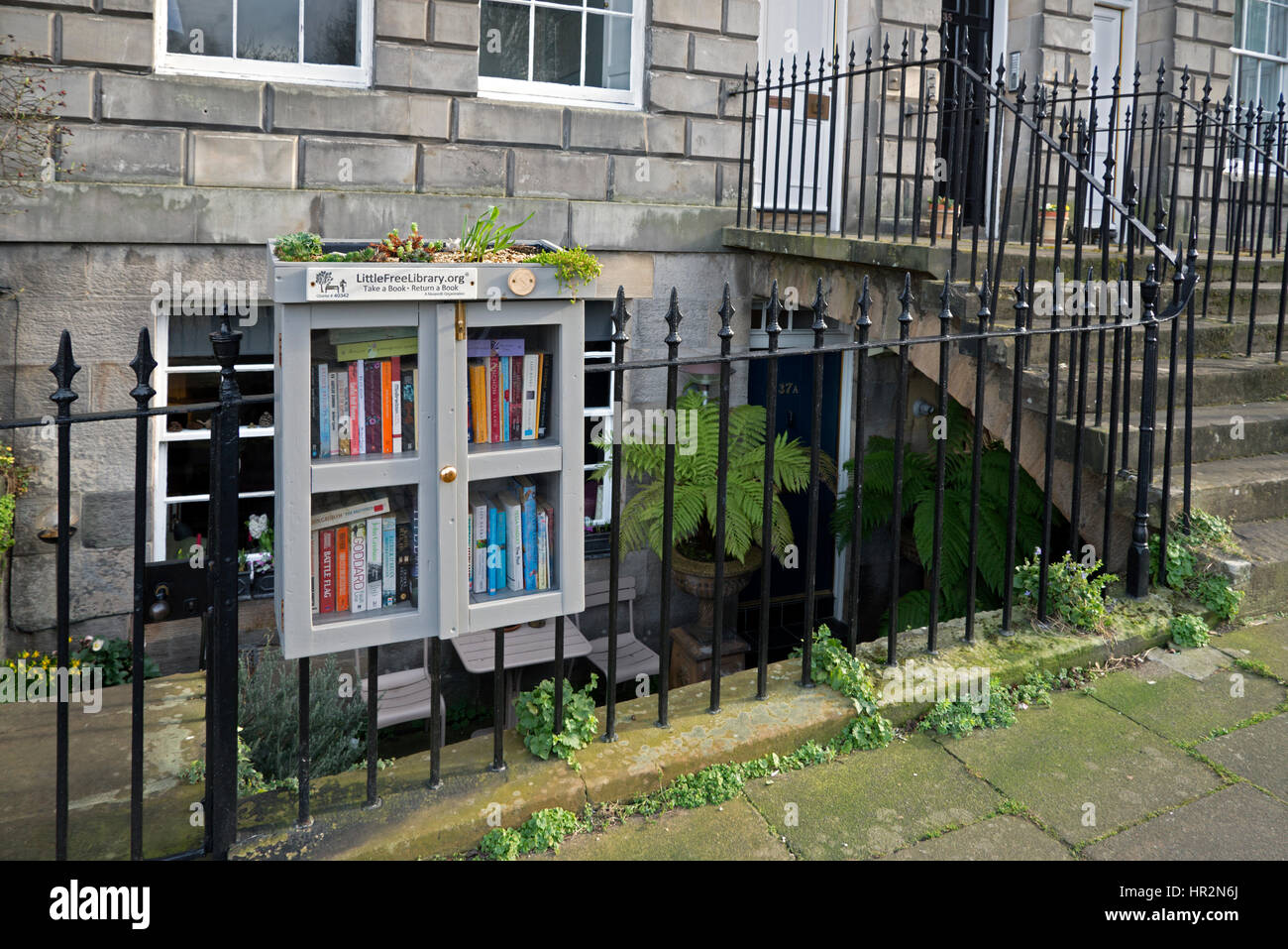 Little Free Library is a nonprofit organization that inspires a love of reading, this library is in Scotland street - Stock Image