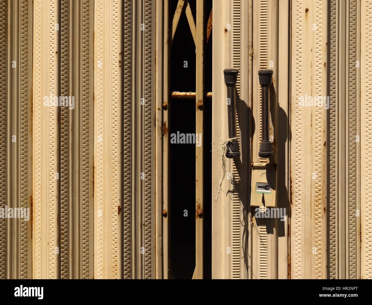 Half-closed metal concertina door close-up view. Bali Indonesia - & Concertina Door Stock Photos u0026 Concertina Door Stock Images - Alamy