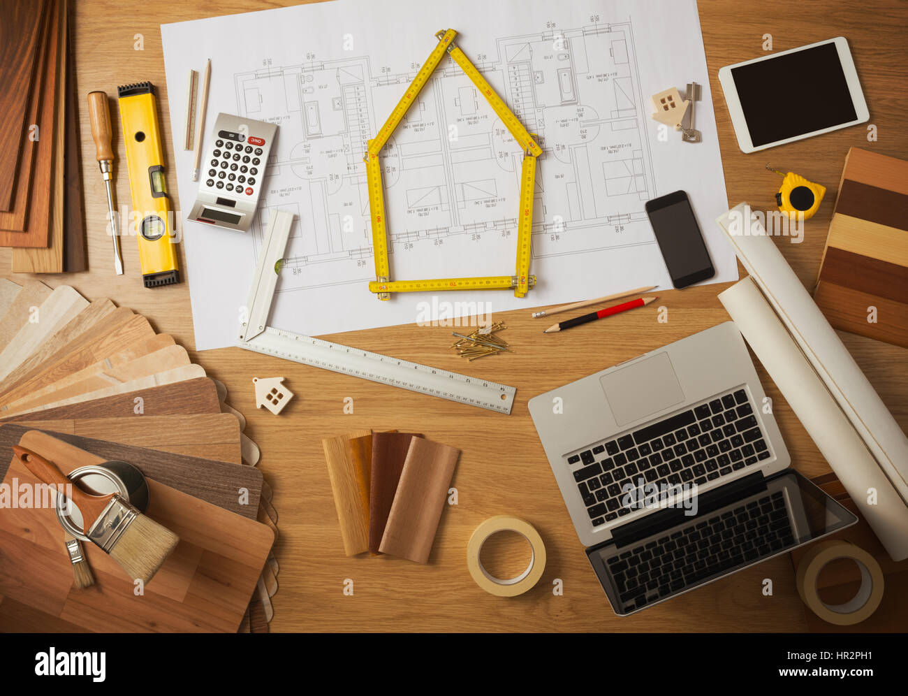 Perfect Architect And Home Interior Decorator Desktop With Tools, Laptop, Wood  Swatches And Home Project Draft Top View, A Meter Is Composing A House At  Cente