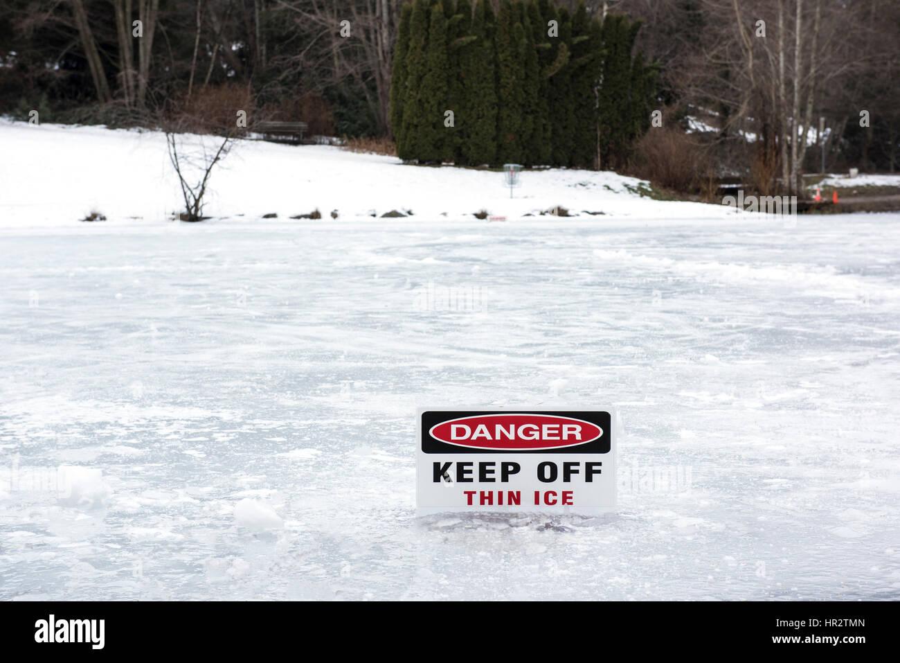 Sign warning of thin ice. - Stock Image