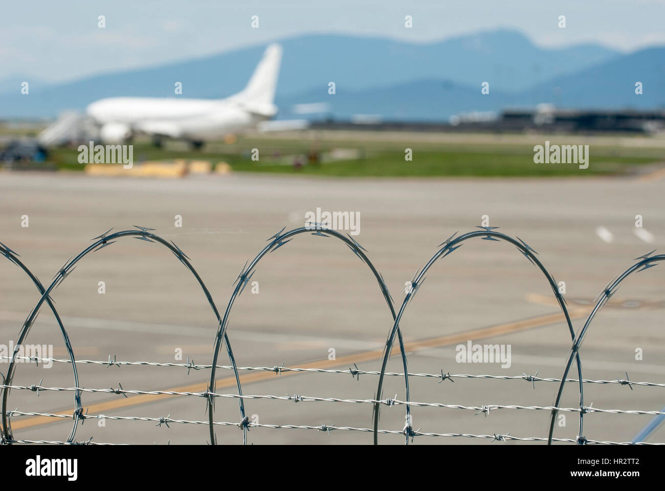 Razor wire used as airport security. Stock Photo
