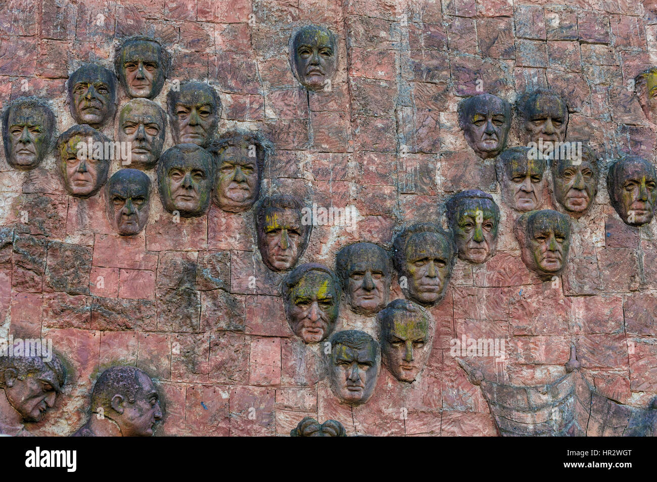 Close-up of faces dating from communist era on façade of City market in Kutaisi, Imereti Region, Georgia, Caucasus, - Stock Image