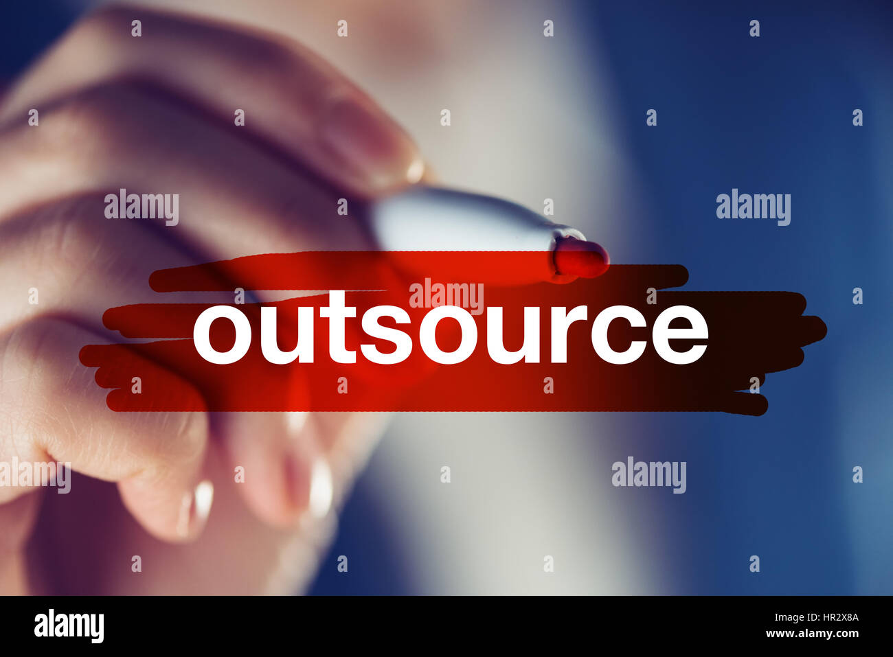 Outsource business concept with businesswoman highlighting word - Stock Image