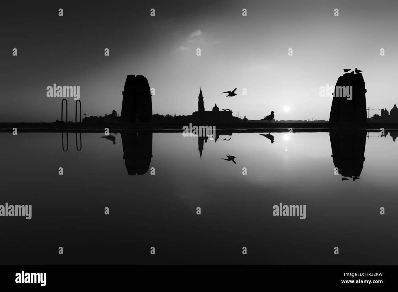 Aqua alta, flooded Riva degli Schiavoni viewing the Isola di San Giórgio Maggiore, Venice, Italy - digitally - Stock Image