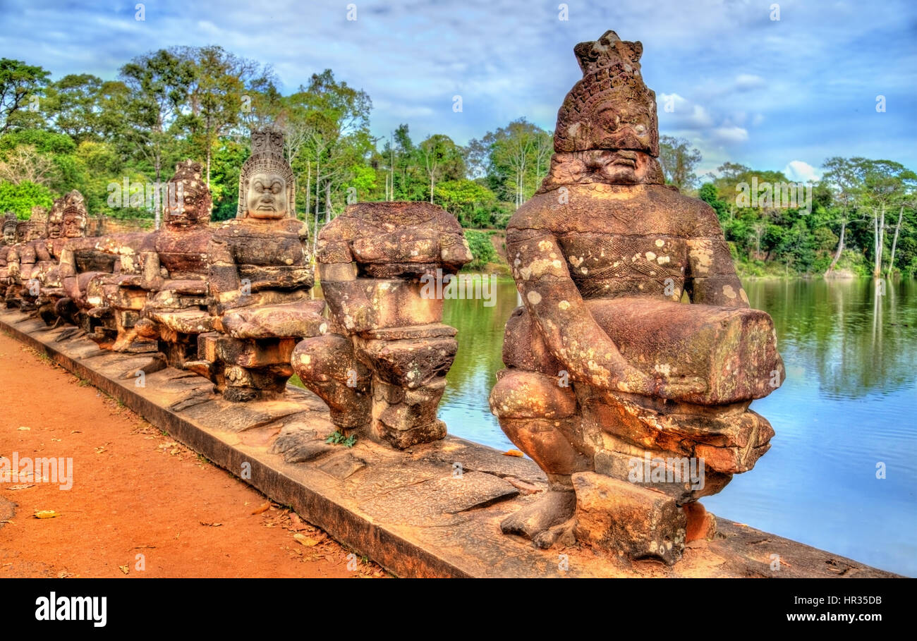 Guardians at the South Gate of Angkor Thom - Siem Reap, Cambodia - Stock Image