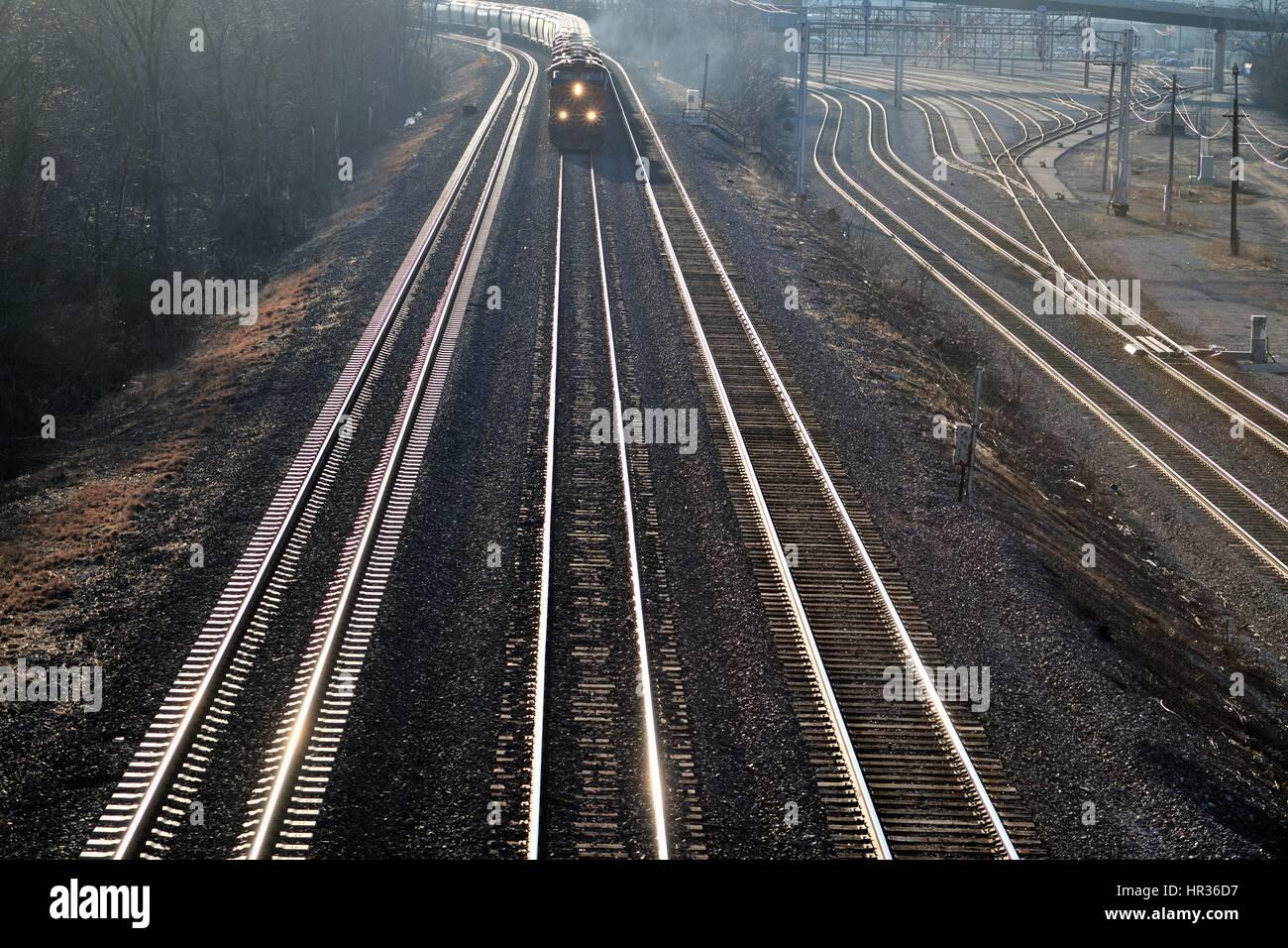 An eastbound Burlington Northern Santa Fe freight train taking a trun in Aurora, Illinois, USA. - Stock Image