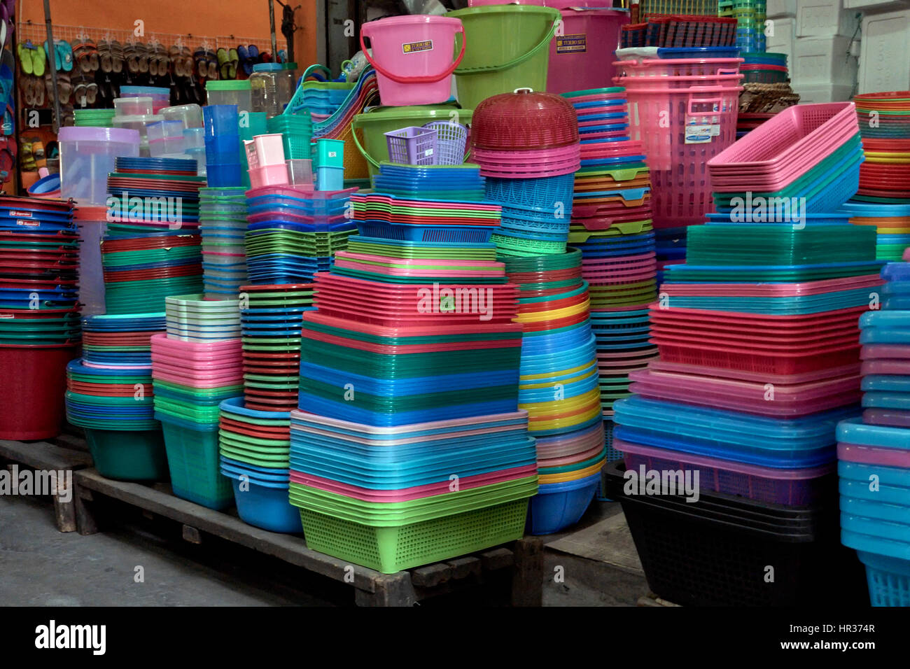 Colorful plastic household goods for sale at a Thailand hardware store. - Stock Image