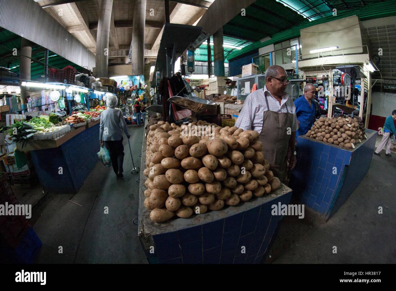 Caracas, Dtto Capital / Venezuela - 04-02-2012 : Man selling potatoes in a famous popular market  Mercado de San - Stock Image