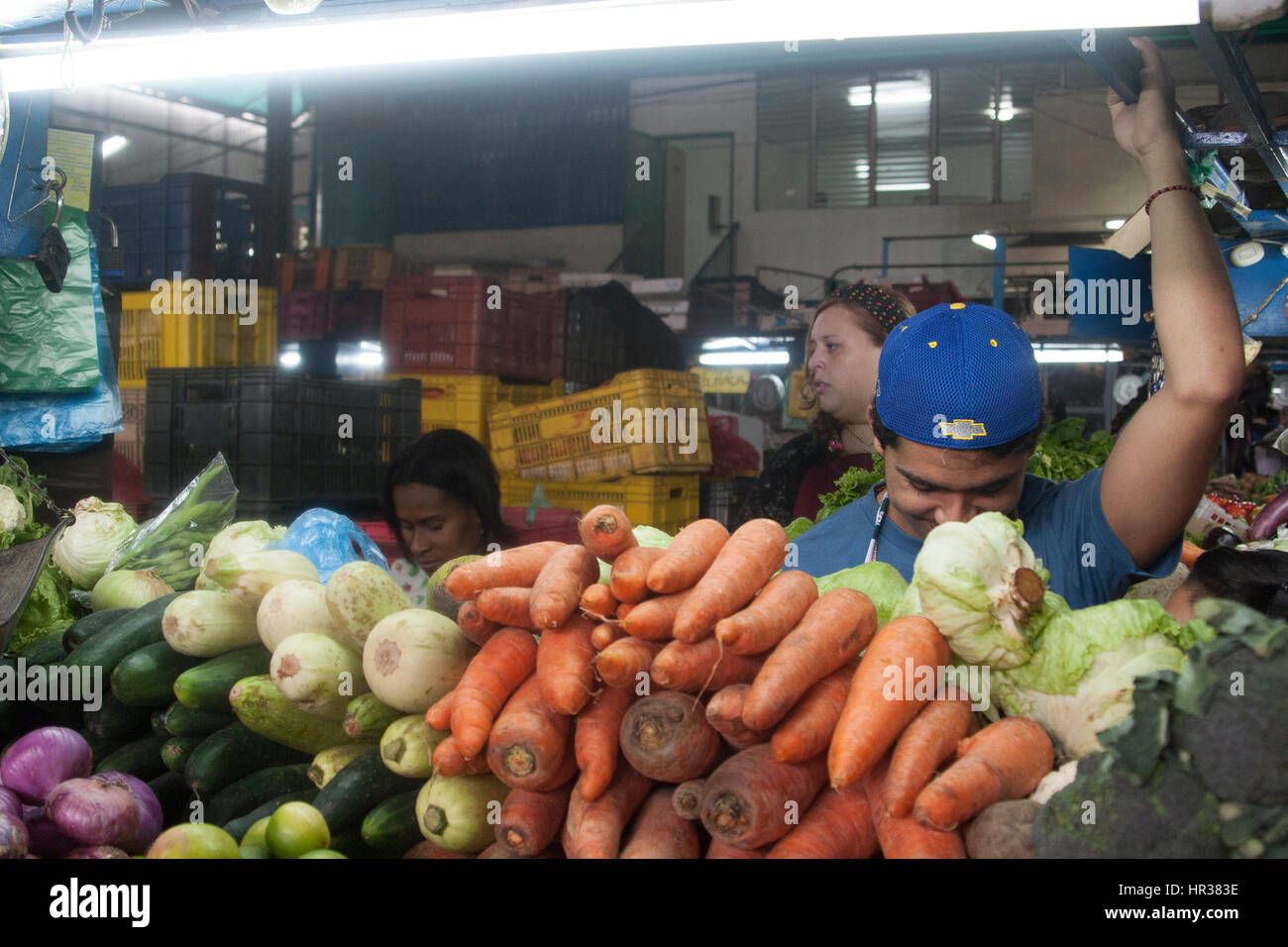 Caracas, Dtto Capital / Venezuela - 04-02-2012 : Man selling some fruits and vegetables in a famous popular market Stock Photo