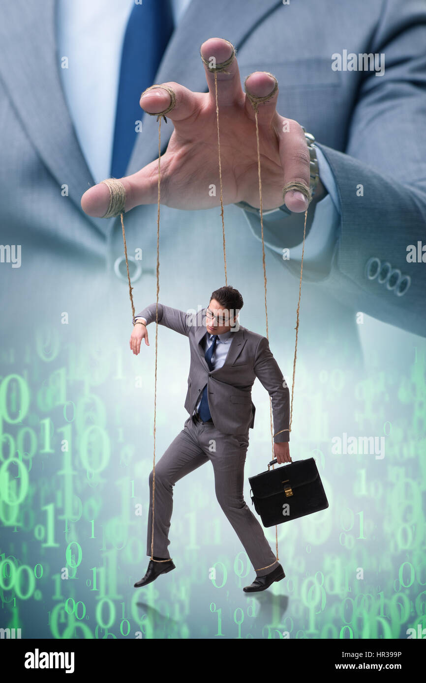 Businessman puppet being manipulated by boss Stock Photo