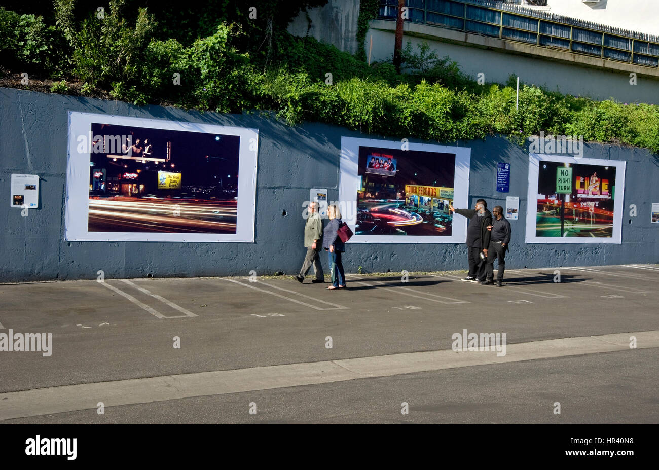 Installation of outdoor art exhibit on the Sunset Strip in Los Angeles featuring Robert Landau's photos documenting - Stock Image