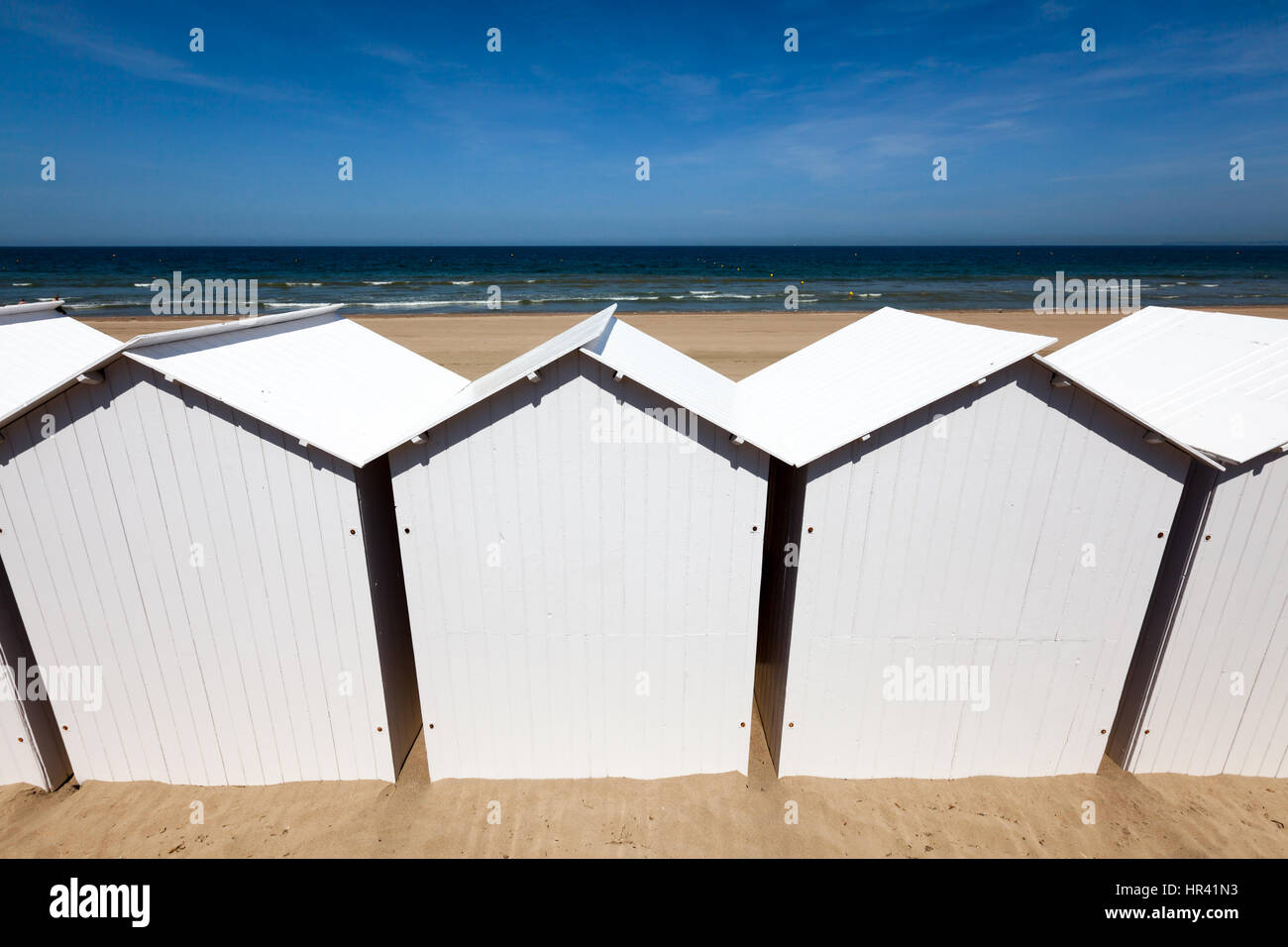 Beach huts for changing on the Normandy coast. - Stock Image