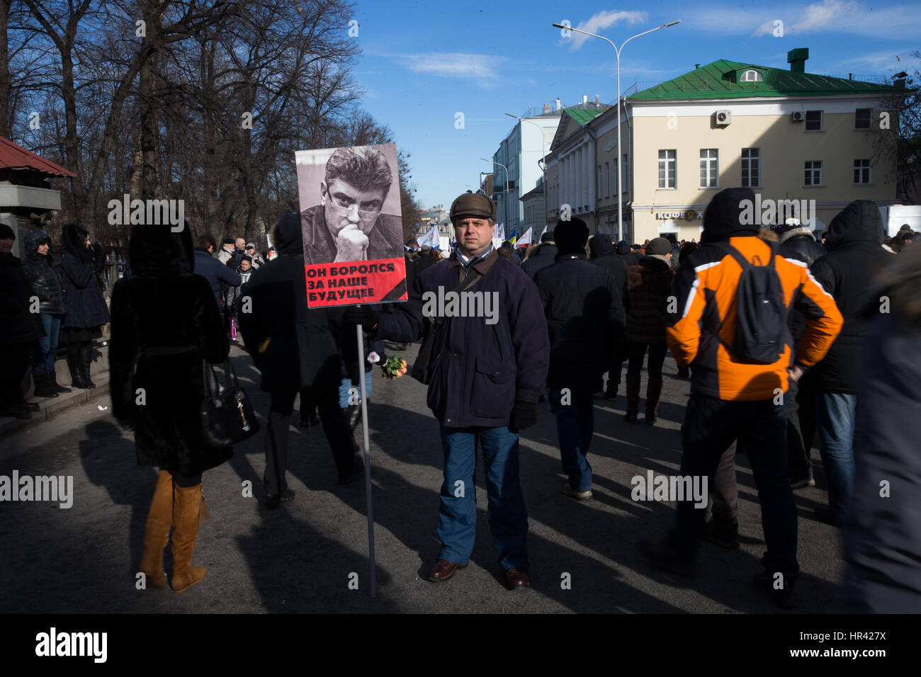 Moscow, Russia. 26th February 2017. A man holds a portrait of Boris Nemtsov reading 'He was fighting for our - Stock Image