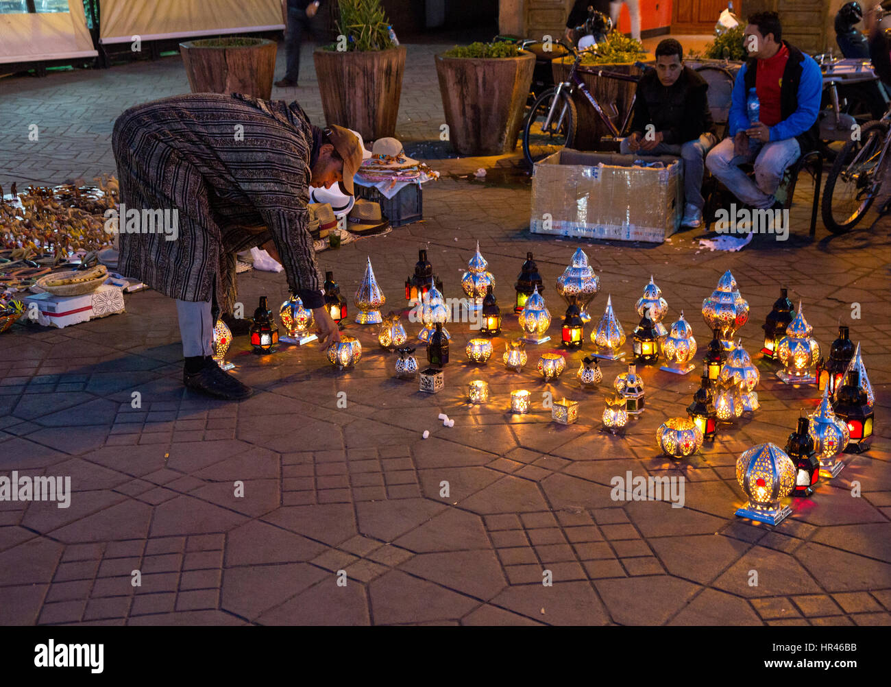 Marrakesh, Morocco.  Vendor Setting out Lamps for Sale in the Place Jemaa El-Fna. Stock Photo