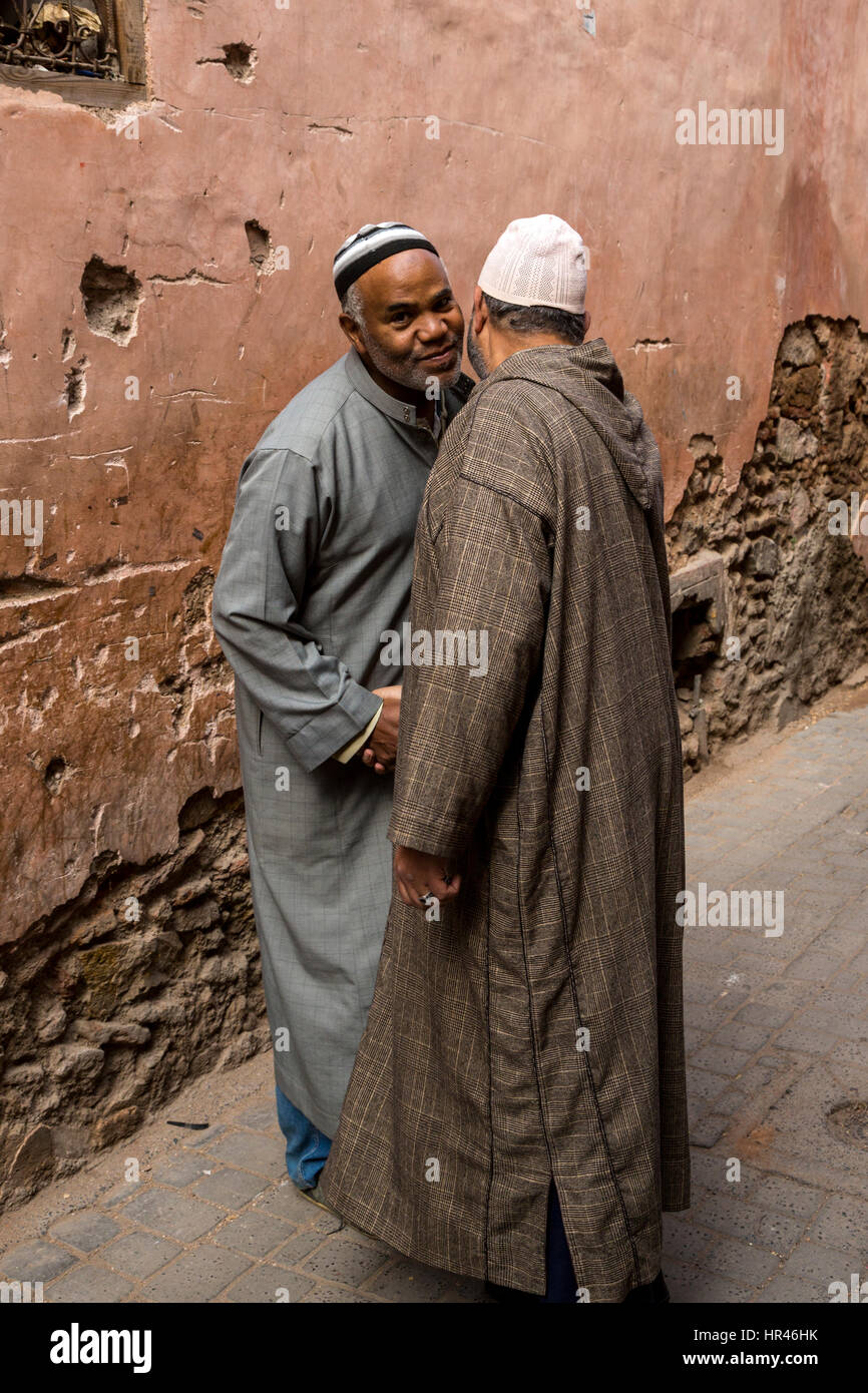 Arab men greeting other stock photos arab men greeting other stock two men greeting each other in the street stock image m4hsunfo