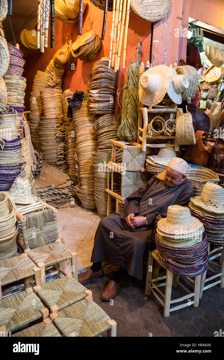 Marrakesh, Morocco.  Straw Hat Vendor Dozing. - Stock Image