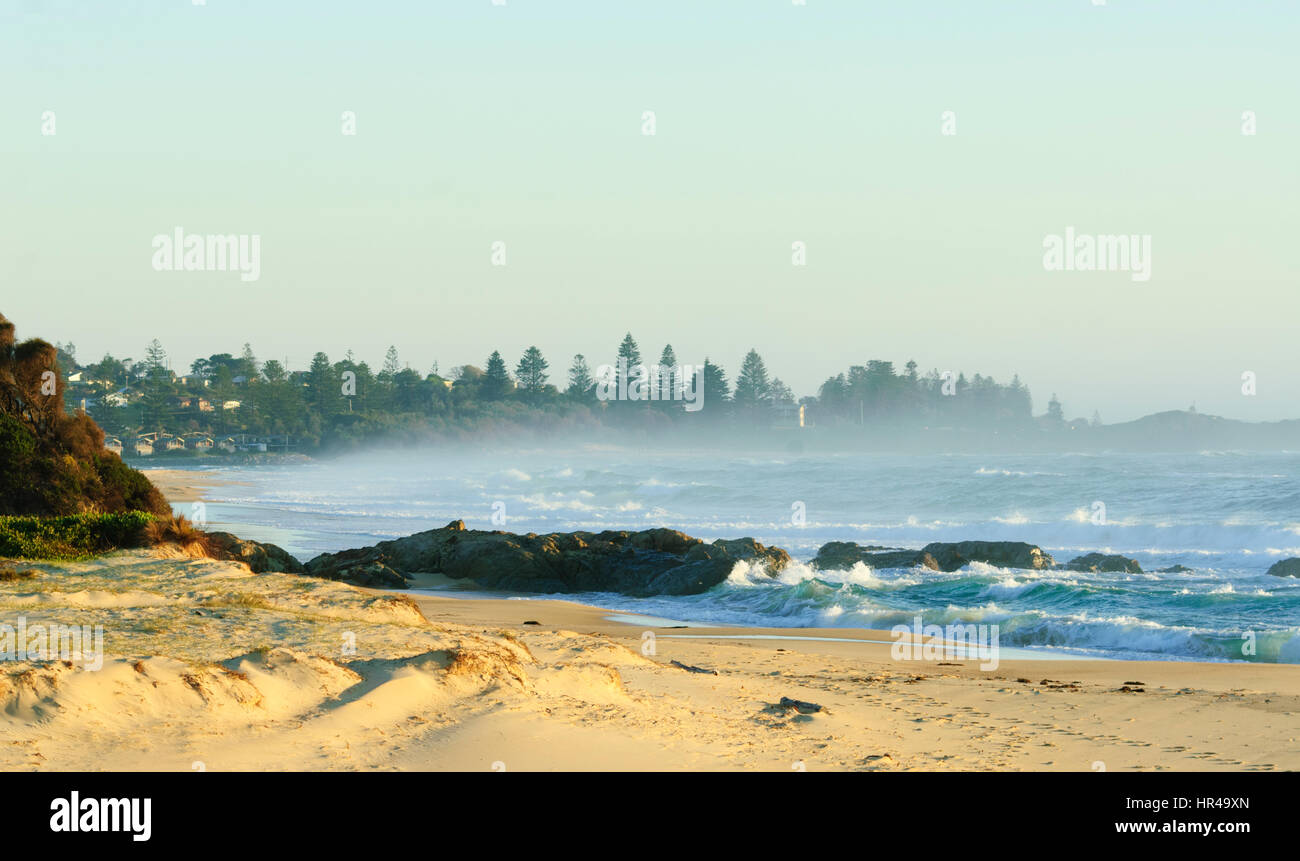 Sea spray early in the morning at Potato Point, New South Wales, Australia - Stock Image