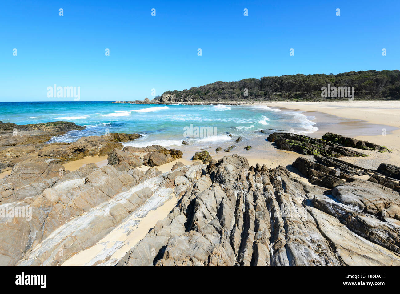 Deserted sandy beach with amazing rock formations at Potato Point, New South Wales, Australia - Stock Image