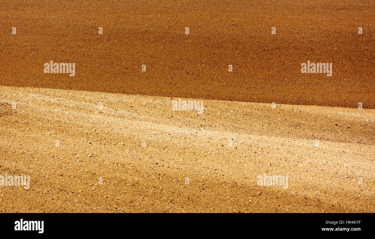 Two tone ploughed and raked farm field - Stock Image