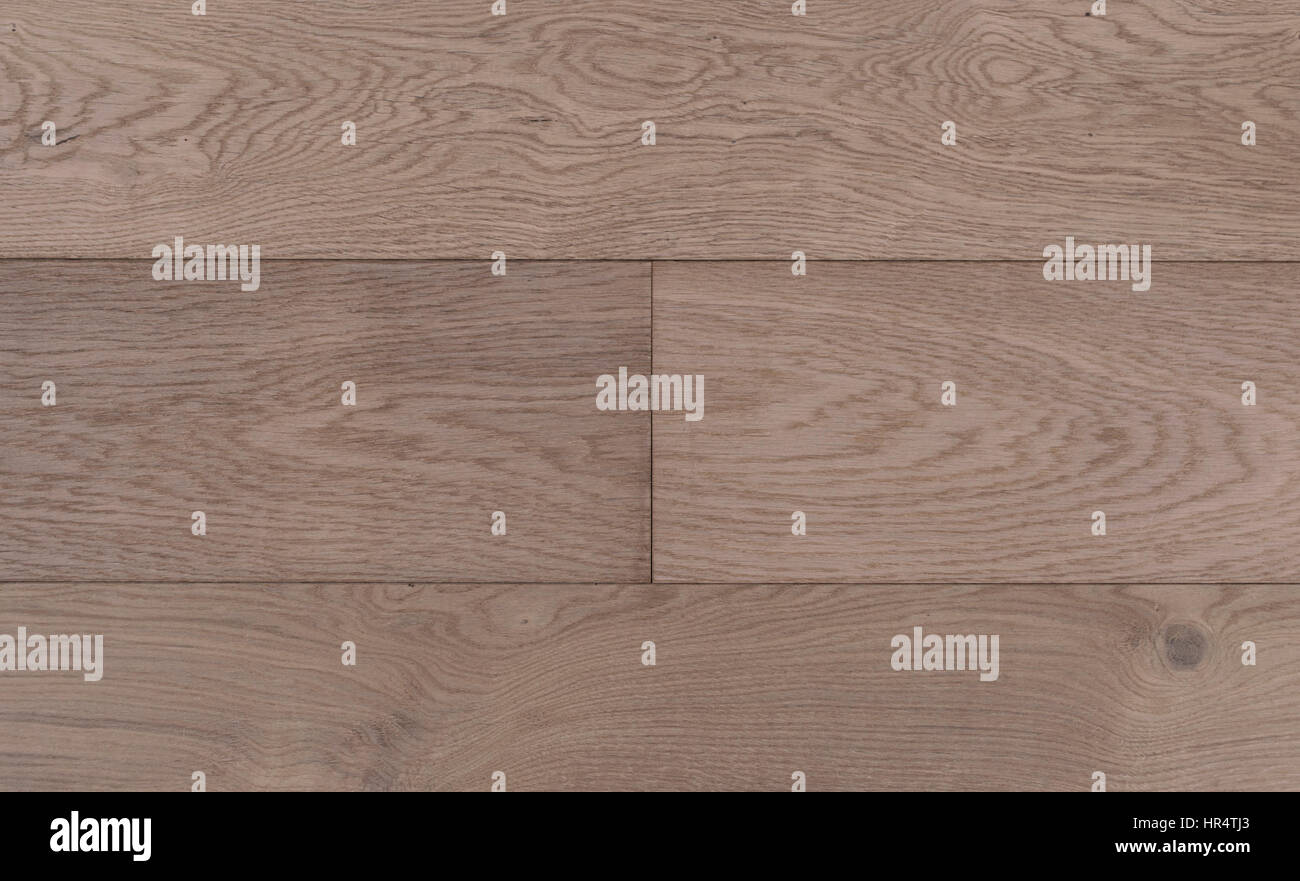 Top view photo of old vintage rustic smoked and white oiled german oak wood floor boards with rough texture Stock Photo