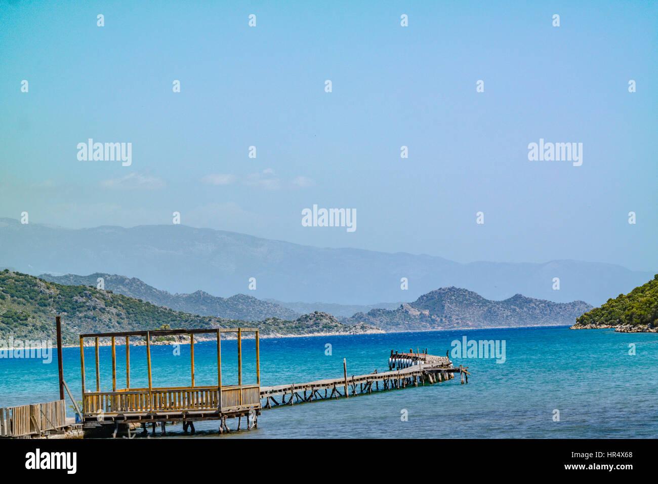 Long pier in to the sea in kekova gulf mediterranean turkey coastline. kekova korfezi denizde uzun iskele deniz - Stock Image