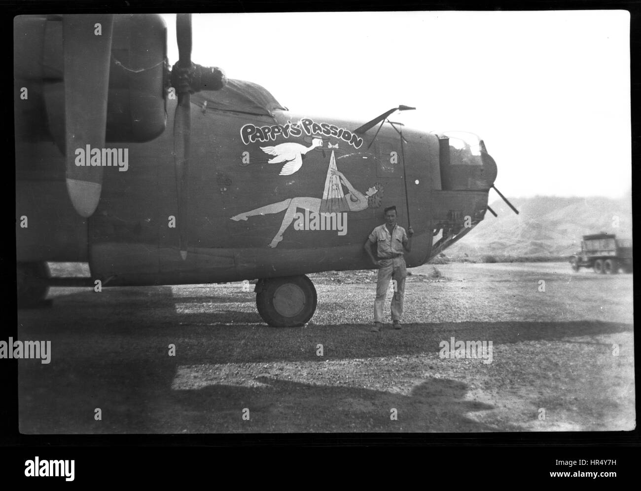 B-24 Pappy's Passion nose art War bird with nose art parked on an air field in New Guinea during WWII. United - Stock Image