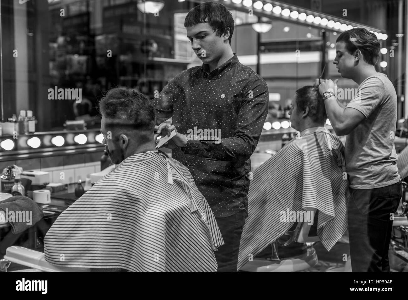 Two men having their hair cut, London, UK - Stock Image