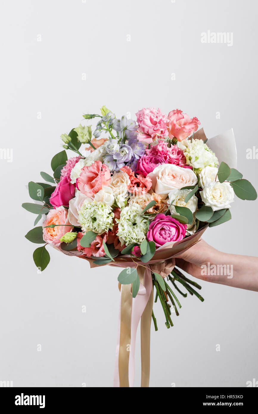 Rich bunch of pink eustoma and roses flowers green leaf in hand rich bunch of pink eustoma and roses flowers green leaf in hand fresh spring bouquet summer background izmirmasajfo