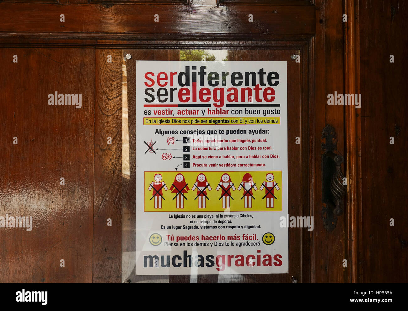 Sign at entrance spanish church, advising dress code and Church etiquette, Marbella, Spain. - Stock Image