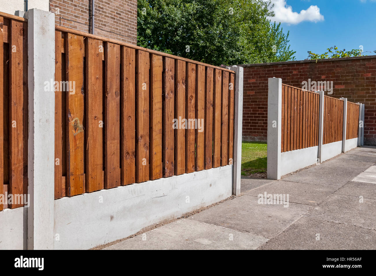 Wooden Garden Fence With Concrete Posts   Stock Image