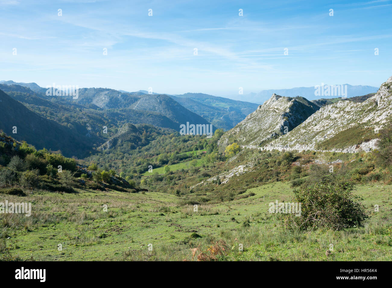 A landscape view of limestone hills and mountains in the Picos de Europa Asturias Spain - Stock Image