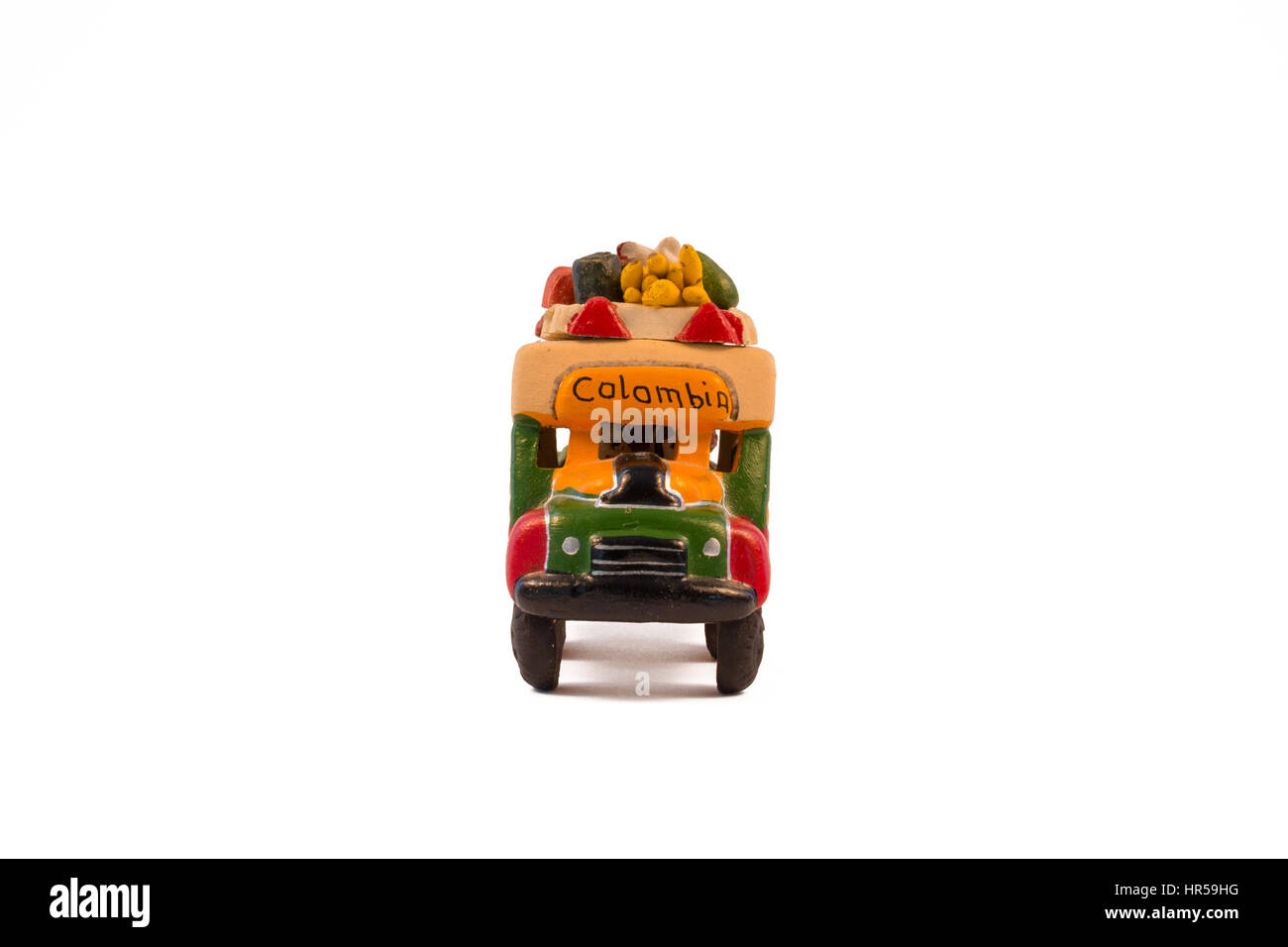 Minature model of a traditional Colombian bus (chiva). Front view, white background. - Stock Image