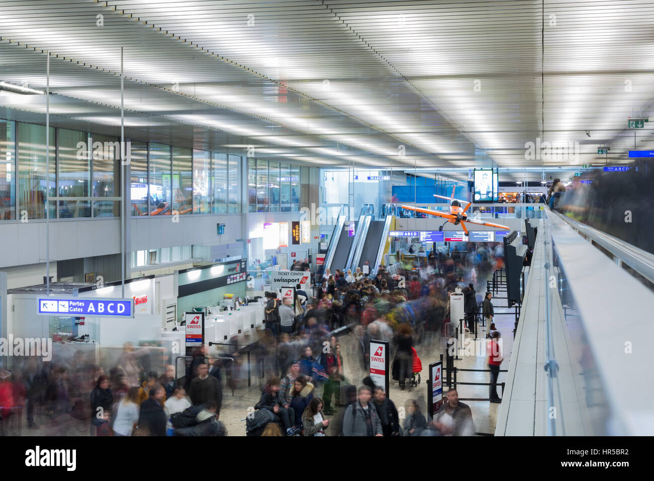 One of the halls of Cointrin airport in Geneva, Switzerland. This airport is international and passengers can fly - Stock Image